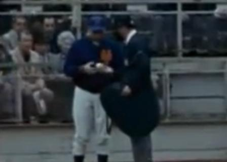 Mets Manager Gil Hodges and Umpire Lou DiMuro examine the ball that allegedly struck batter Cleon Jones in game five of the 1969 World Series