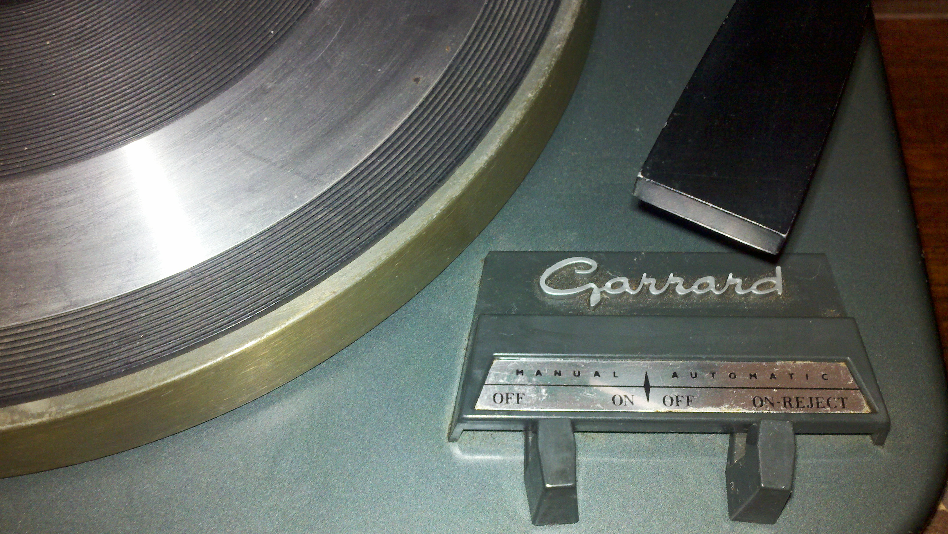 Many record turntables featured a semi-automatic reject mechanism